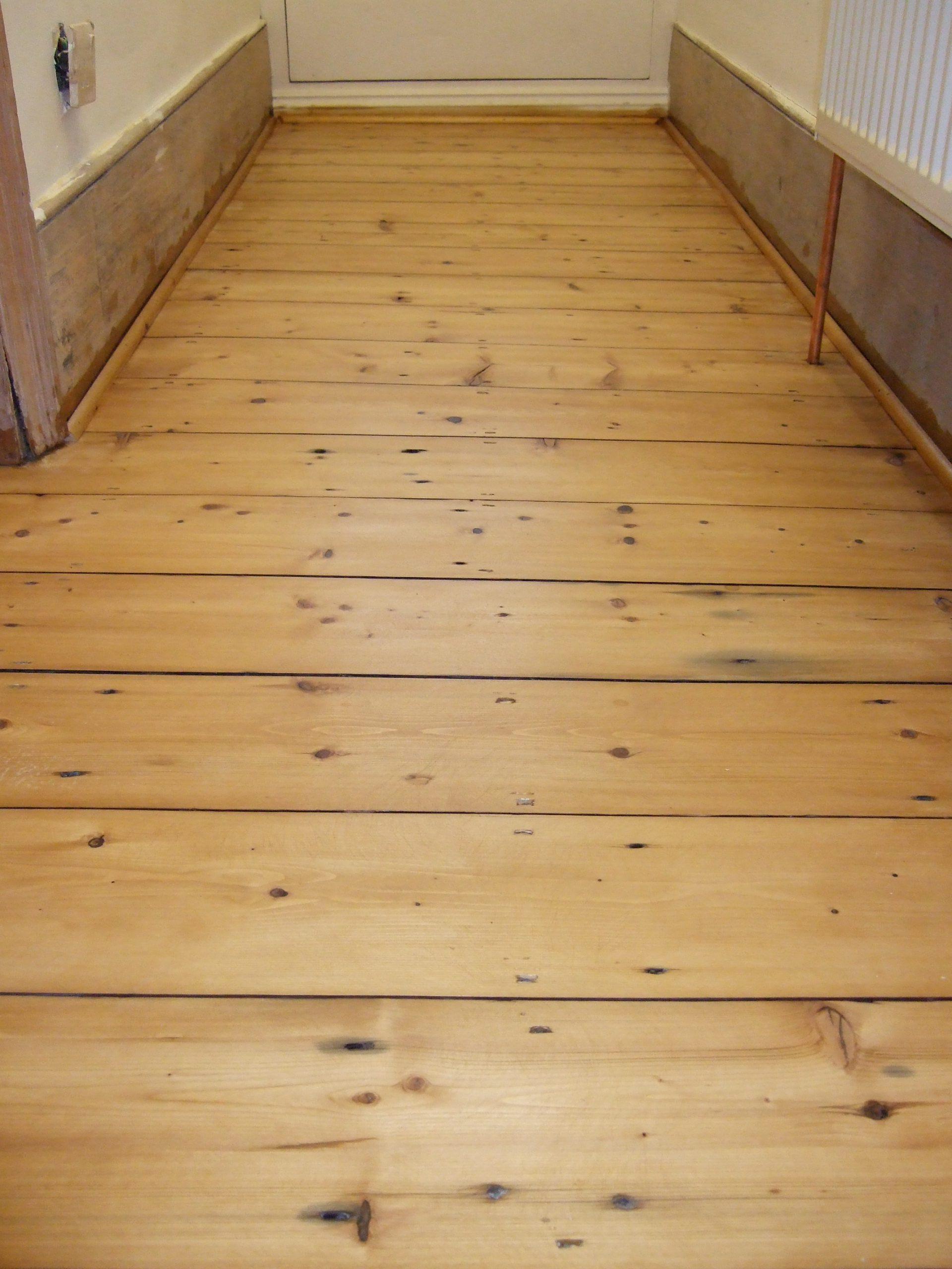 Old pine floor repaired with wonderful reclaimed Lancastrian floor boards