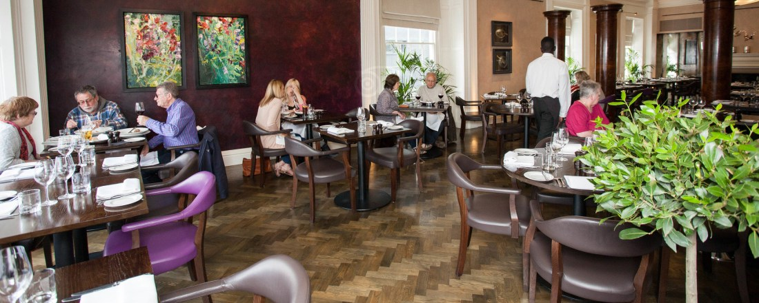 The Oak Room restaurant of The Angel Hotel Abergavenny showing smoked oak herringbone parquet floor