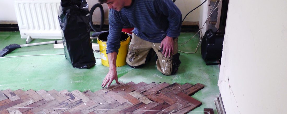 reclaimed mahogany parquet floor being laid