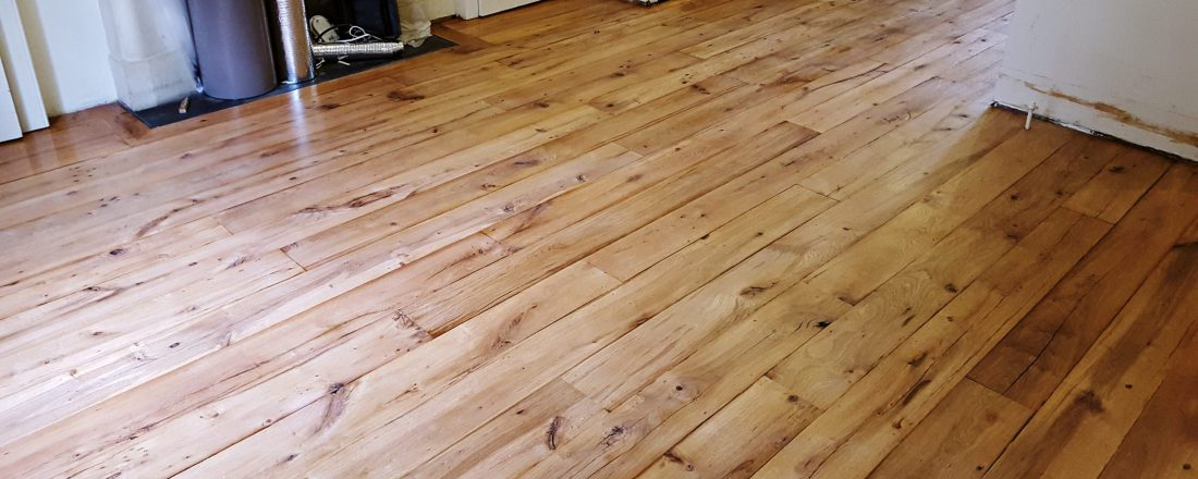 Beautiful reclaimed oak floor removed, new sub floor installed, top floor installed again sanded and finished