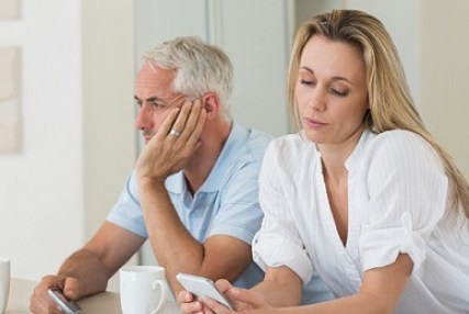 Empty nest age couple with conflict and distance in relationship. This image is meant to portray the disconnect that is remedied by a marriage retreat or marriage seminar in New England.