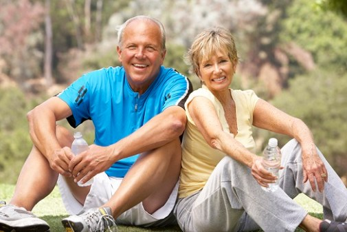 Empty Nest age couple sitting together relaxed. Image represents a couple who had fallen out of love and felt not good enough prior to attending a Hold Me Tight Workshop. Couple now knows how to fix a marriage and resolve conflicts.