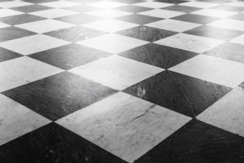 Black/white tiled floor portraying the extreme conflicts couples may engage in if they have not attended an EFT marriage intensive in Maine, an EFT marriage intensive in Connecticut, or an EFT marriage intensive in Massachusetts.