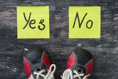 Red sneakers on person pointing at 2 yellow stickies with 'yes' and 'no' on them. This image is meant to portray how hopeless couples can feel in a relationship and the need for a couples therapy retreat in Maine, a couples therapy retreat in Connecticut, or couples therapy in Longmeadow, MA.