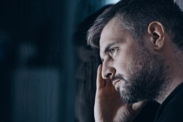 Man sitting thoughtfully. This image is meant to portray the withdrawer; a role we see in Emotionally Focused Couples Therapy.