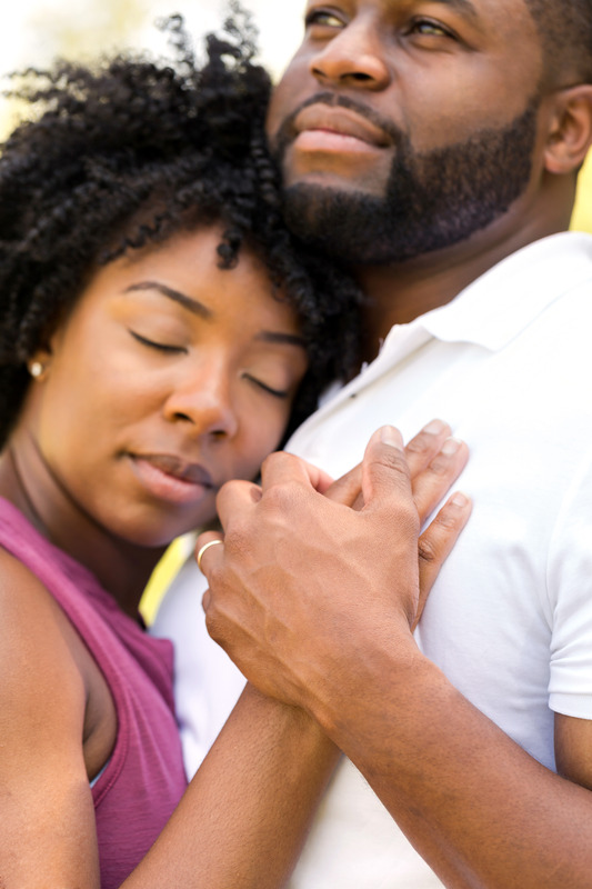 African-American couple embracing happily. This image is meant to represent a healthy relationship and emotionally connected couple who have attended a Hold Me Tight Workshop in Massachusetts with New England Hold Me Tight.