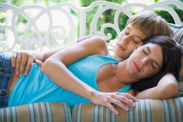 Lesbian couple spooning. This image is meant to portray emotional connection from attending a Hold Me Tight Workshop for lesbians or an intensive couples retreat for lesbian couples.
