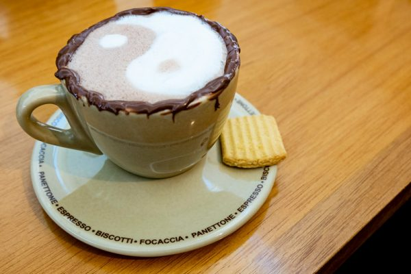 Hot chocolate with ying/yang symbol on top. This is meant to signify emotional connection and balance a couple experiences in emotionally focused intensive couples therapy in New England.