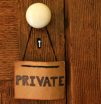 Privacy sign hanging from the doorknob of an old wood door. Signifies boundaries LGBT couples learn when attending an eft couples retreat in Massachusetts.