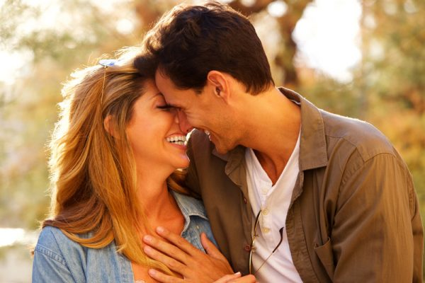 Middle aged couple smiling at one another in a close embrace. This signifies feeling emotionally connected after attending an eft marriage intensive in Massachusetts or emotionally focused intensive couples therapy in Massachusetts.
