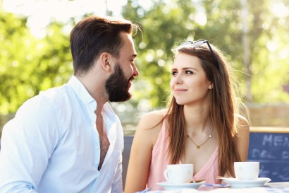 Young couple talking in a cafe. Image signifies improved emotional connection and relationship tools from attending emotionally focused intensive couples therapy in Massachusetts or an eft marriage intensive Massachusetts.