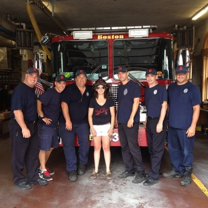 Giving Hats to Fire Fighters that fought the Back Bay Fires