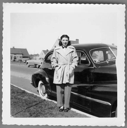 Figure 7. Period photograph of woman in front of car in Levittown, New York (University of Illinois as Chicago)