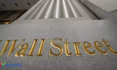 Wall Street ekes out gains to close languid week