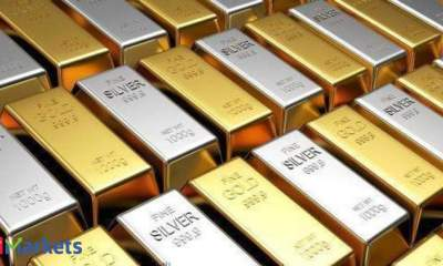 Gold prices inch higher on softer dollar; set for weekly fall