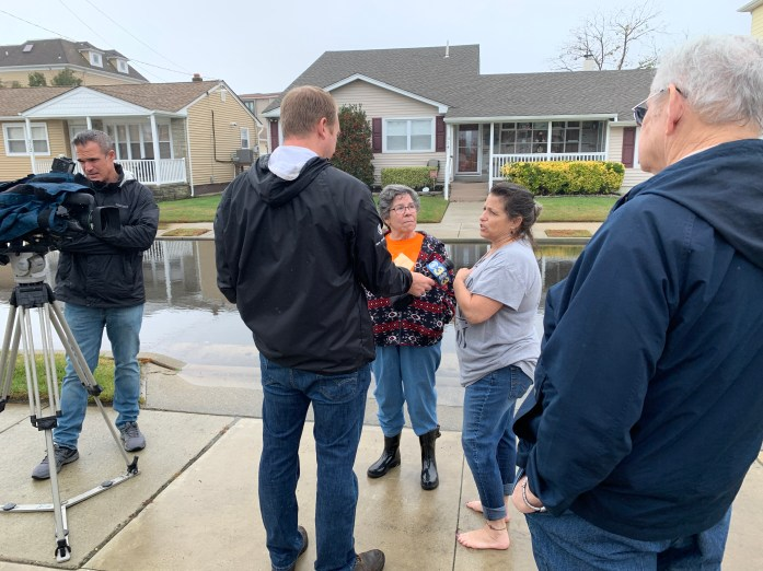 Jody and Fran being interviewed on the seventh anniversary of Superstorm Sandy on Fran's flooded street