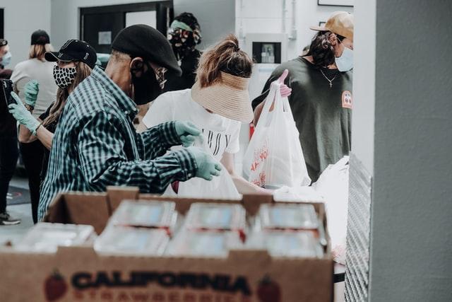 Volunteers sorting groceries (Image credit: Unsplash.com)