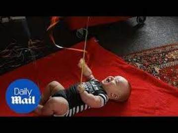 Baby laughs at balloons tied to hands and feet - Daily Mail - YouTube