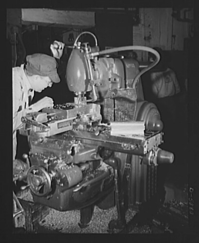 Here a 20th century milling machine is used to manufacture airplane components. Image source: Library of Congress
