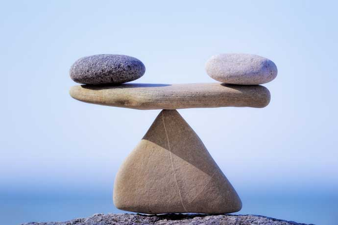 T.J. McMullan says balance, like these stacked stones, is key.