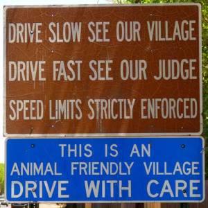 Corrales warning sign