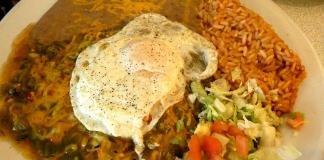 Gordo's cafe blue corn cheese enchiladas, with green chile and topped with an egg