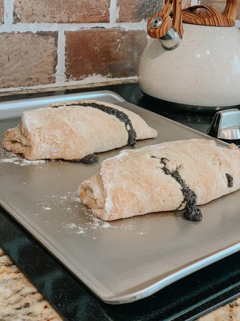Two Poppyseed rolls on sheet pan
