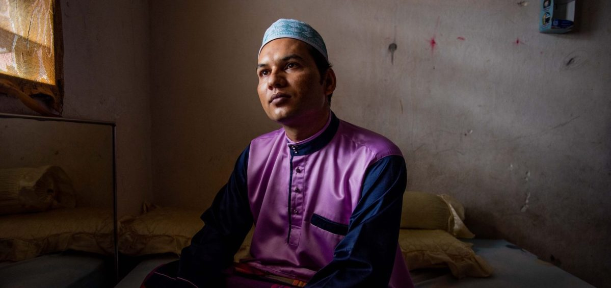 Abdul Hussin poses for a portrait at his home in Penang, Malaysia on 17 August 2018. After years of trying, his family is finally preparing to leave Malaysia for a new life in Canada.