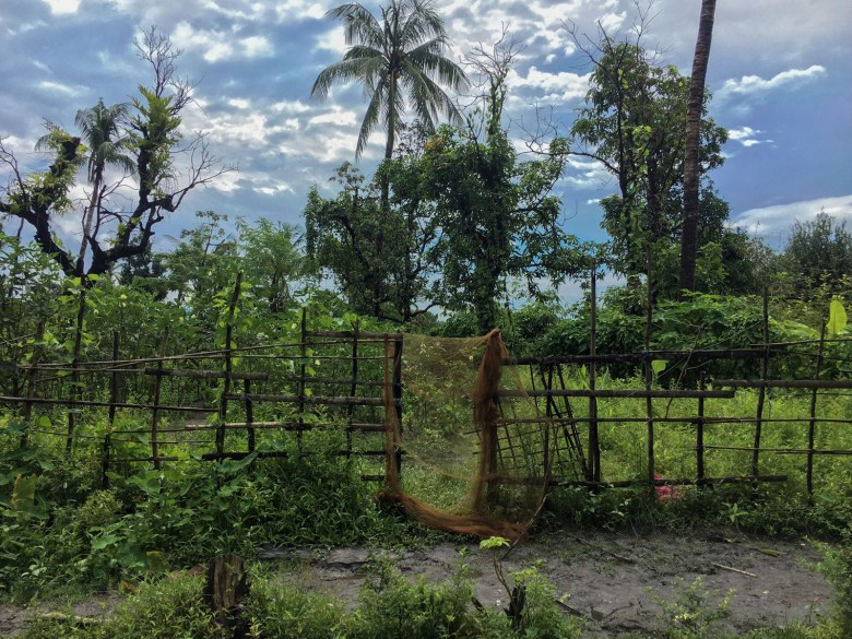 A burnt fence surrounds the remains of the Rohingya section of Inn Din Village in Myanmar's Rakhine State on 26 September 2018.