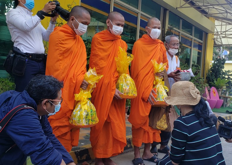 Sitanun Satsaksit receives a blessing from monks near the Mekong Gardens condominiums in Phnom Penh's Chroy Changva District on 9 December 2020.