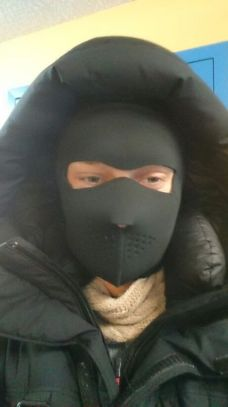 Michel Larsson wearing a ski mask