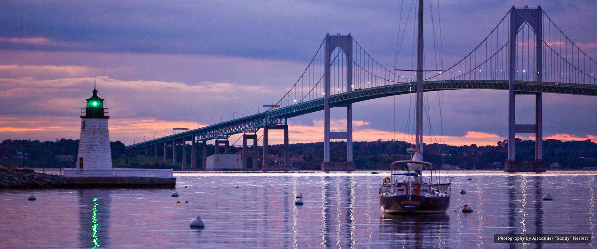 The lighthouse infront of the bridge | Newport Inns of Rhode Island