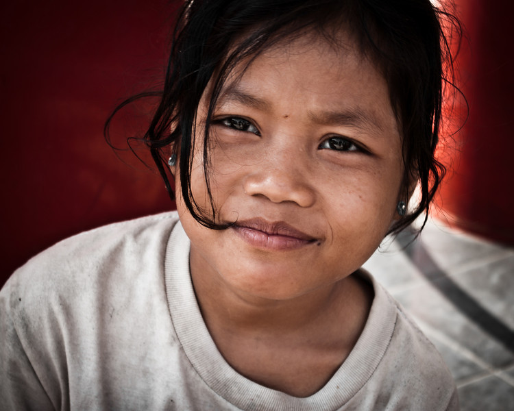 A beggar girl on the street in Battambang, Cambodia