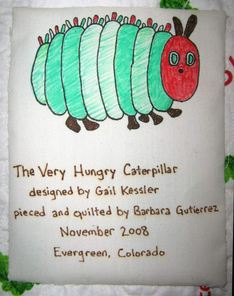 Photo of quilt label with Very Hungry Caterpillar hand drawn on it
