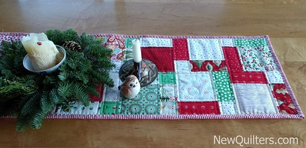 Photo showing disappearing nine-patch table runner with seams bracketed