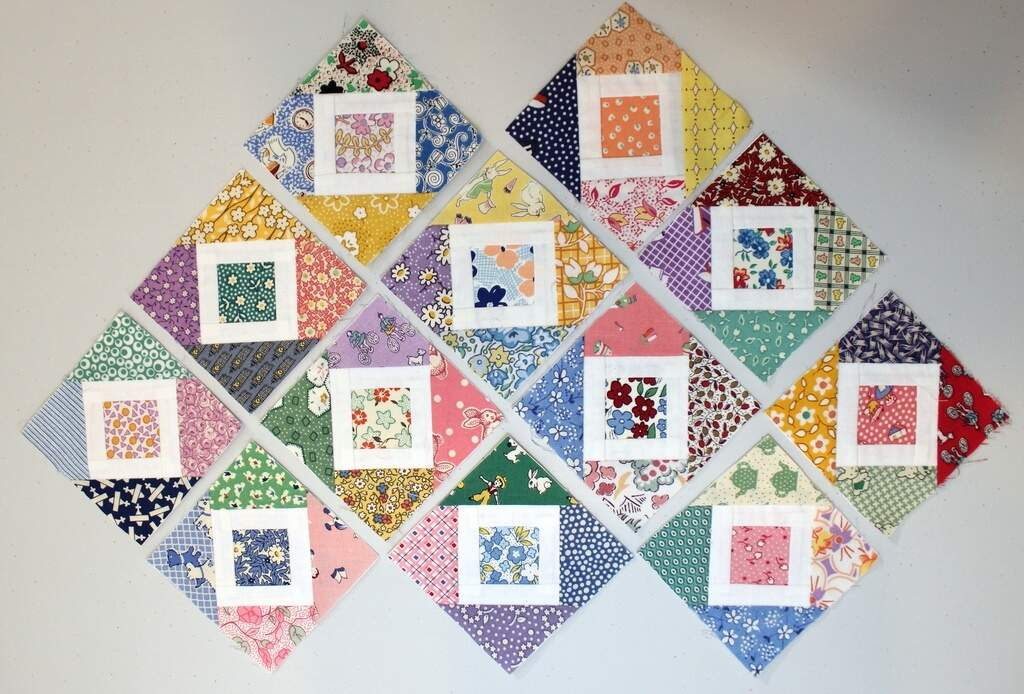 Photo of 1930s reproduction paper pieced quilt blocks