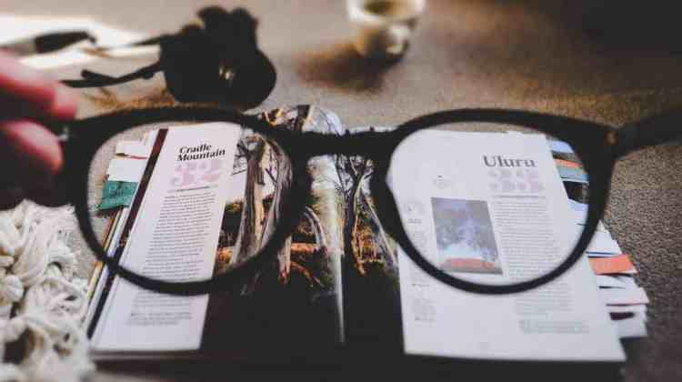 Looking at a book through glasses