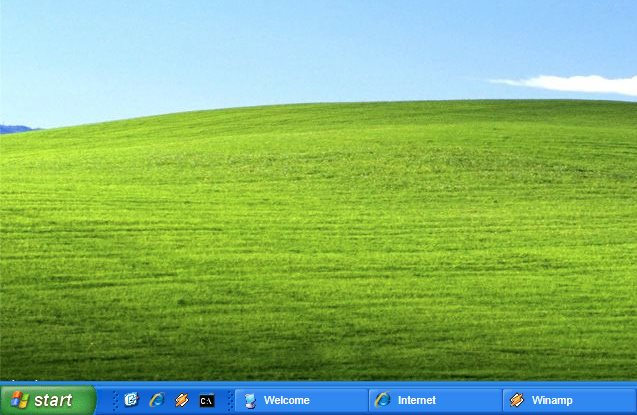 The Windows XP show desktop icon in the taskbar