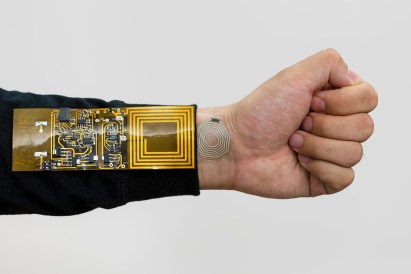 The rubber sticker attached to the wrist can bend and stretch as the person's skin moves, beaming pulse readings to a receiver clipped to the person's clothing.