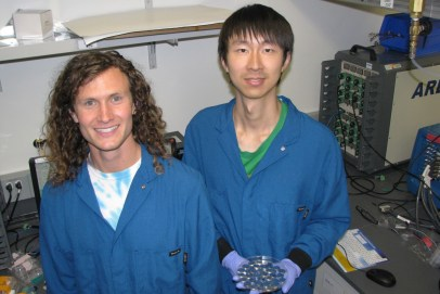 PhD students David Mackanic, left, and Zhiao Yu in front of their battery tester.