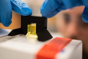 Graduate student Daniel Sazer preparing a scale-model of a lung-mimicking air sac for testing