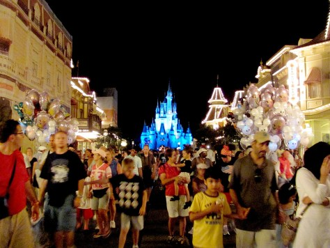 Families leaving the Magic Kingdom, DisneyWorld, Orlando, Florida after firework. Tourism is a key industry for Florida but families may think twice about vacationing in the state if it approves open carry law, says MomsRising.org © 2015 Karen Rubin/news-photos-features.com.