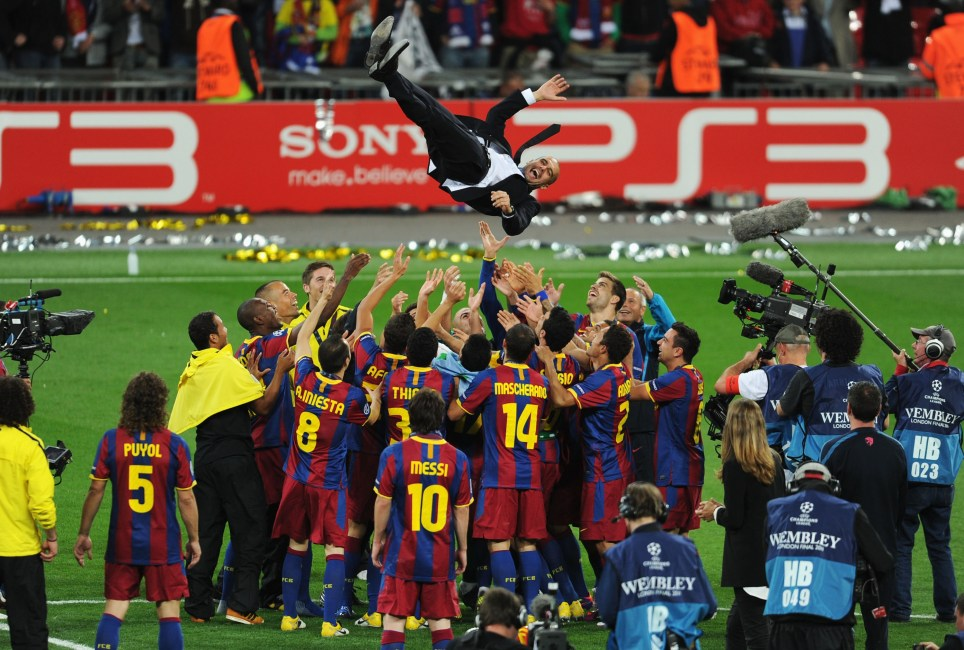LONDON, ENGLAND - MAY 28:  Josep Guardiola manager of FC Barcelona is thrown in the air as Barcelona celebrate victory in UEFA Champions League final between FC Barcelona and Manchester United FC at Wembley Stadium on May 28, 2011 in London, England.  (Photo by Michael Regan/Getty Images)