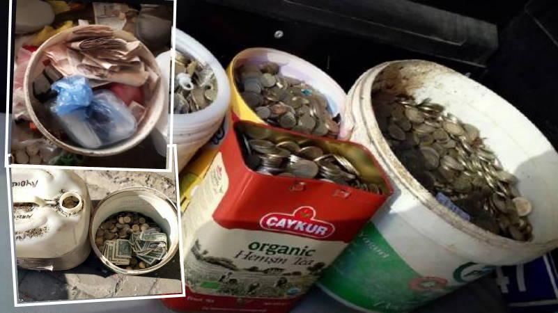 Полные ведра денег среди кучи мусора