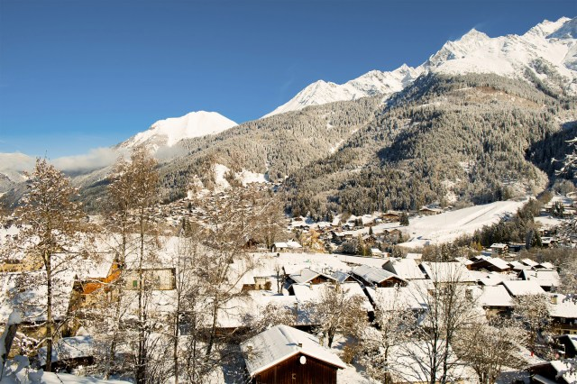 Winter view of Mont Blanc and Les Contamines village in Chamonix, France.