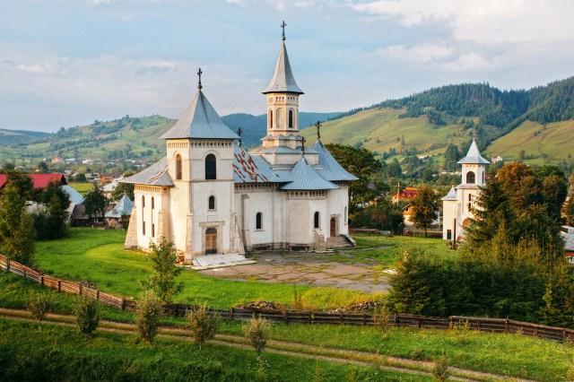 Romanian mountain landscape and church.