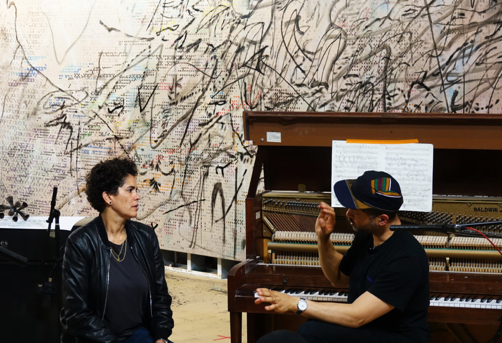 Julie Mehretu and Jason Moran collaborate on their project, (2017). Courtesy of Damien Young.
