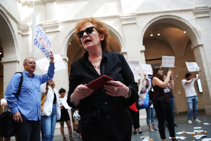 Nan Goldin leads a demonstration at the Harvard Art Museums in Cambridge, MA on July 20, 2018 to protest the benefactor of the Sackler Art Museum. Photo by Erin Clark for The Boston Globe via Getty Images.