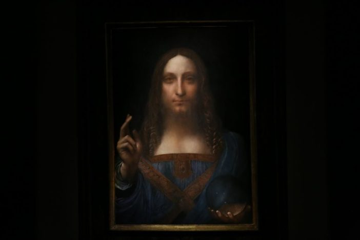 Leonardo da Vinci's Salvator Mundi painting is seen at the Christie's in New York in 2017. Photo by Mohammed Elshamy/Anadolu Agency/Getty Images.