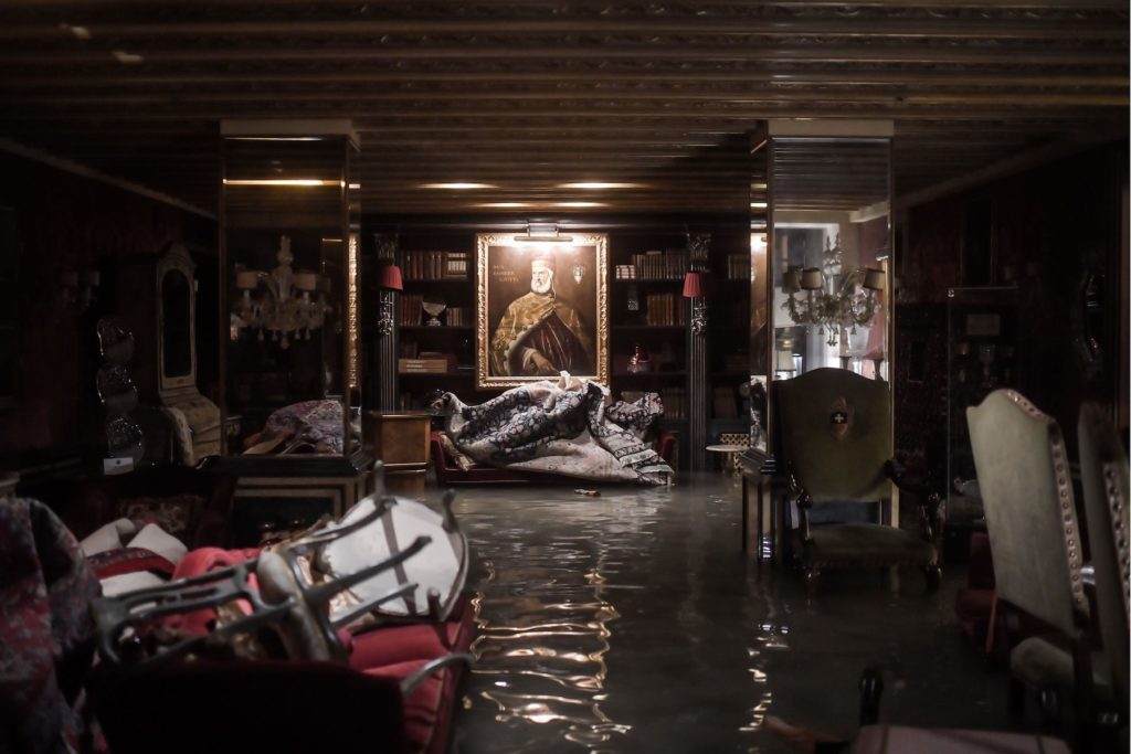 A room in the flooded Gritti Palace during the floods on November 12 in Venice. Photo by Marco Bertorello/AFP via Getty Images.